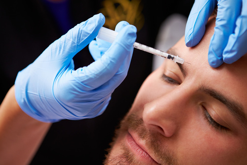 A man during a Botox procedure in Rochester Hills, MI